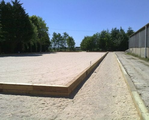 Outdoor horse arena in Gloucestershire marked out for dressage.
