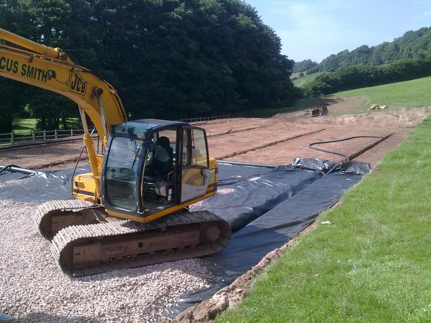 Outdoor horse arena under construction in Gloucestershire.