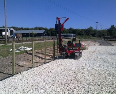 Fencing being constructed for outdoor horse arena.